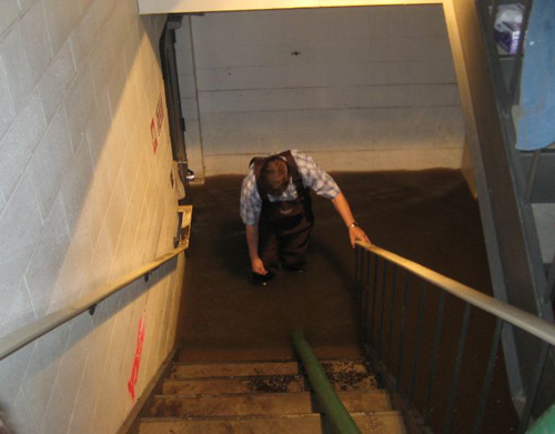 technician in flooded basement