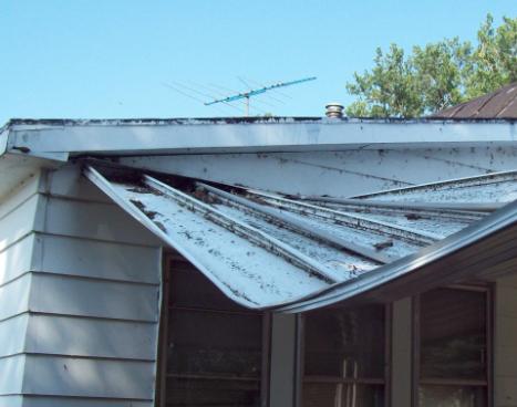broken roof due to storm