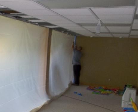 tech putting up tarp