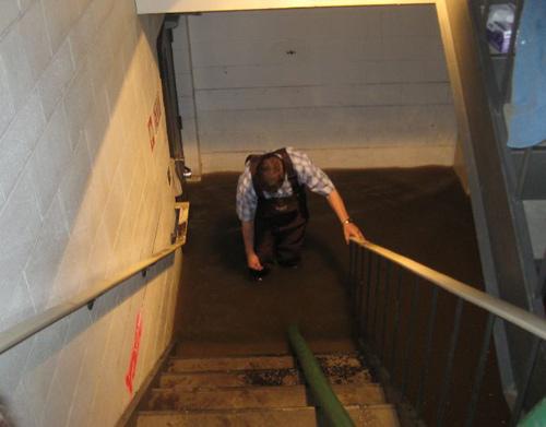 tech in flooded basement