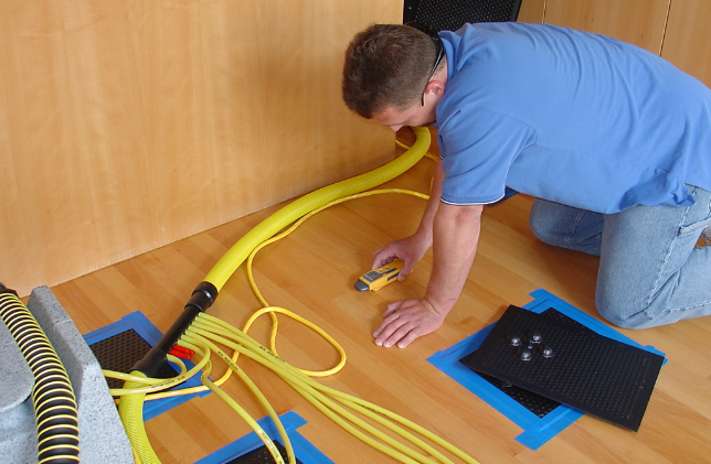 technician using moisture detector